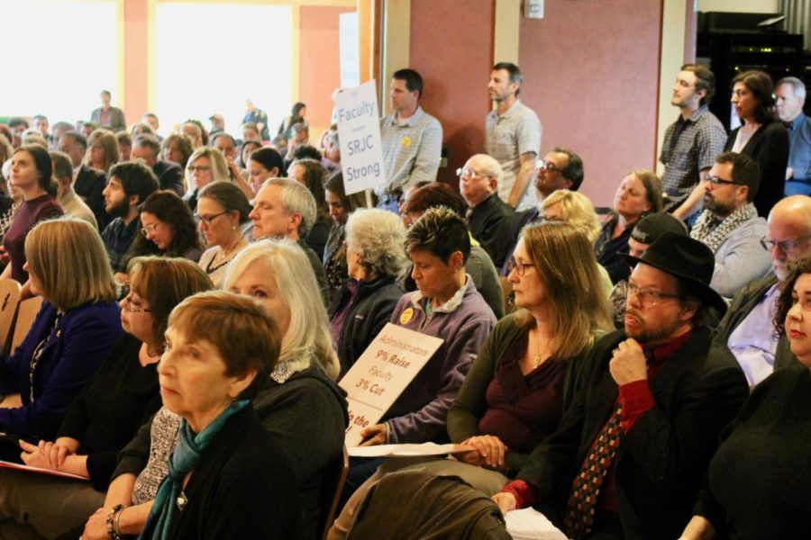 Crowds fill Bertolini Hall leaving standing room only during Tuesdays Board of Trustees meeting.