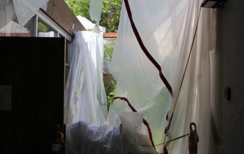 Blown-over tarps hang over Baker Hall.
