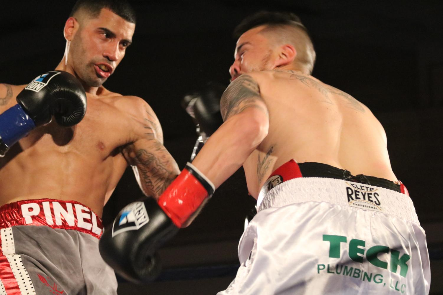 Ricardo Pinell (left) connects with a left hook against Enrique Gallegos (right) in the first round of their bout at the Battle of the Ballroom in San Francisco April 7.