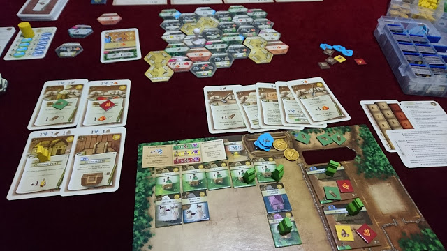 By+the+second+era%2C+%22The+Colonists%22%27s+play+area+is+crowded+with+cards%2C+notes+and+game+pieces.