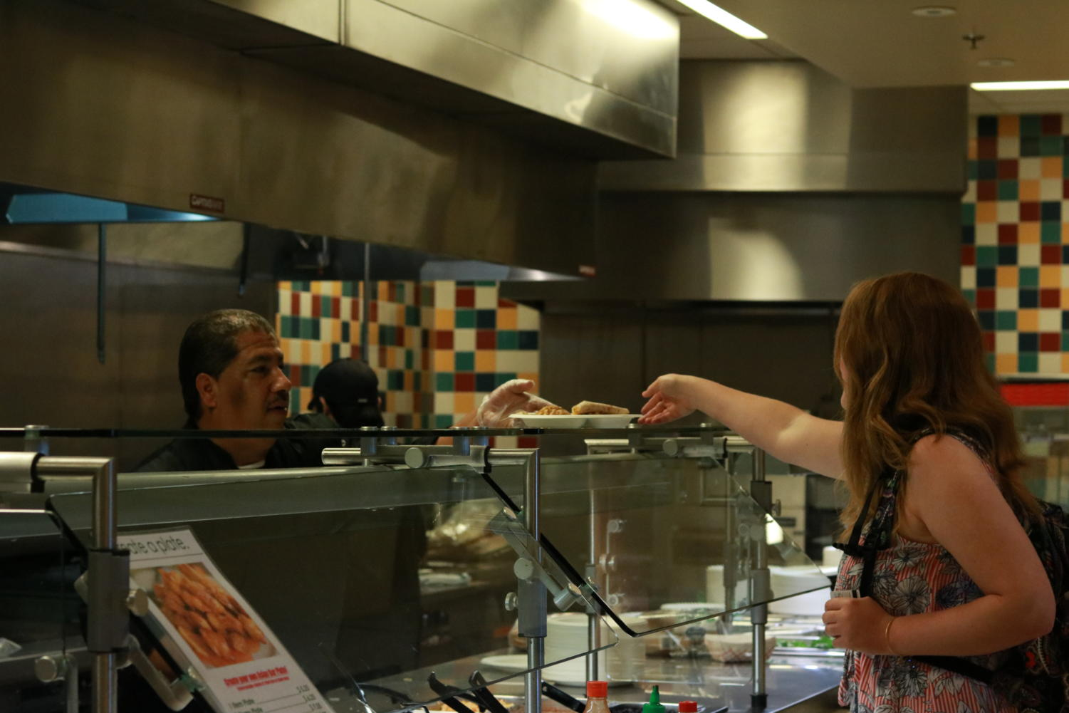 SRJC chef preps and hands-off meal to hungry student.