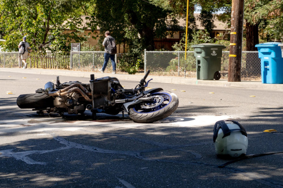 Yamaha motorcycle collided with a minivan on Elliot Avenue, with front suspension bent.