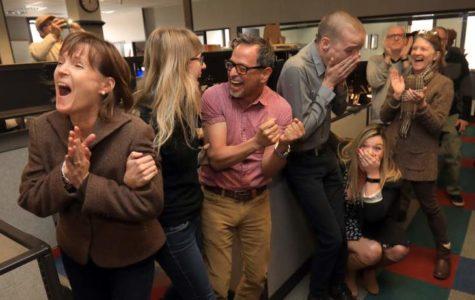 Espinoza (center) and colleagues celebrate the Press Democrat's Pulitzer win.