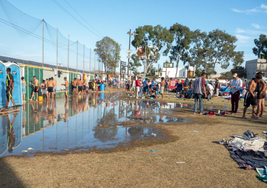 Migrants shower after the 100-mile drive from Mexicali to Tijuana.