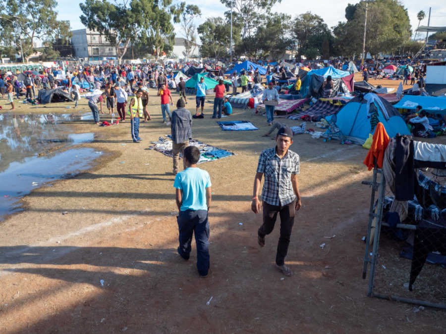 The stadium already exceeding capacity still continues to grow as water from the showers begins to flood an overcrowded tent city.