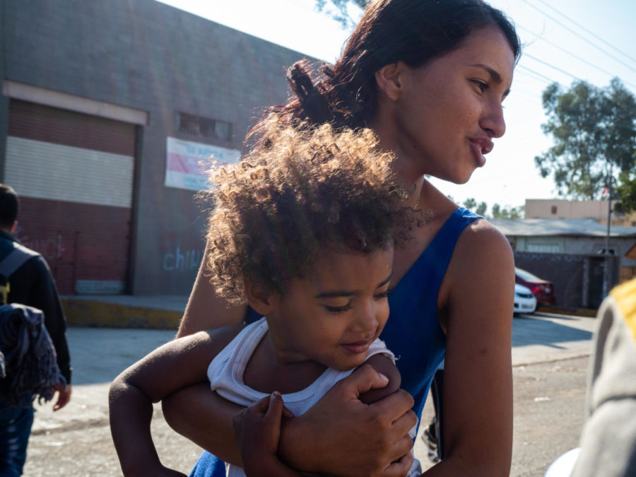 Getting out of a semi-truck, packed with over 50 people, a 16-year-old girl and her nephew take a walk for fresh air.