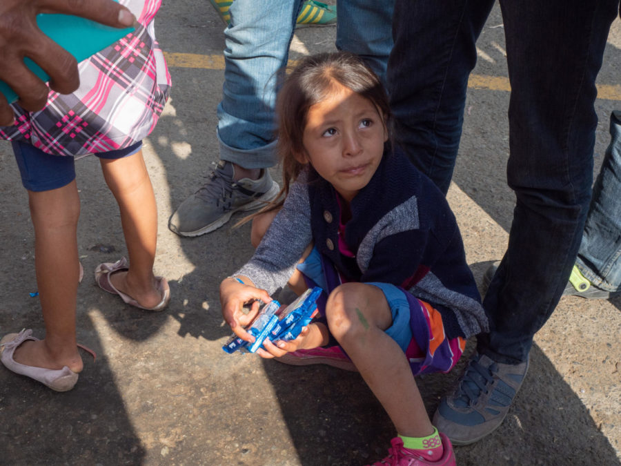 A child cries as her uncle explains the disappearance of her mother the night before.
