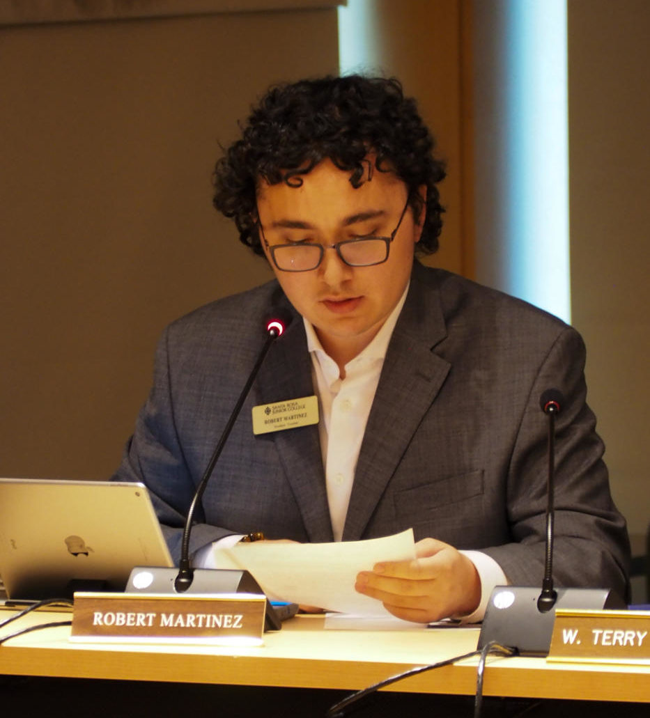 Student Trustee Robert Martinez reads his plans for the newly-formed Student Trustee Advisory Group