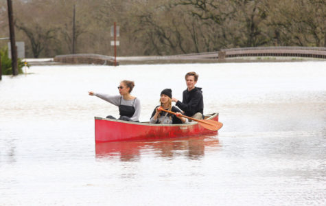 Students from Analy High school brought a canoe to explore the flooded areas of Sebastopol after school was cancelled the previous day.