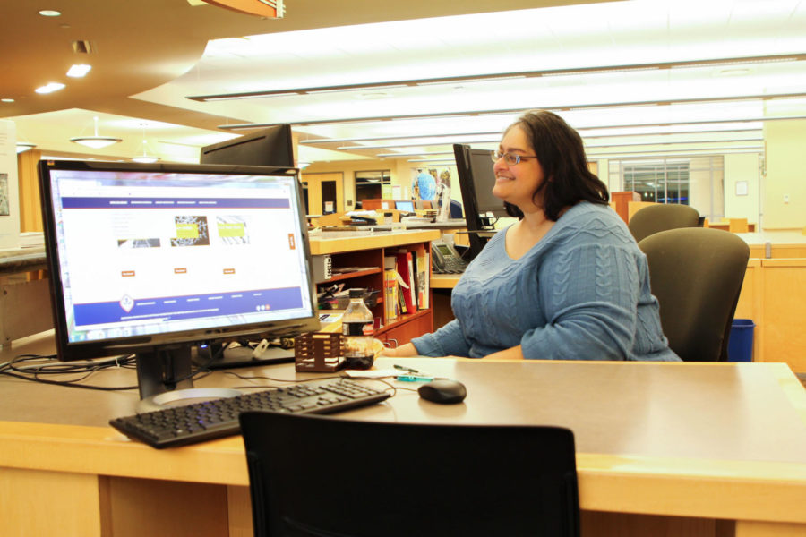 Smita Avasthi, a public services librarian, works at the reserve desk inside Doyle library.