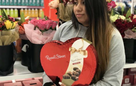 Santa Rosa resident Jasmine Rosas buys herself a box of chocolates for Valentine's Day.