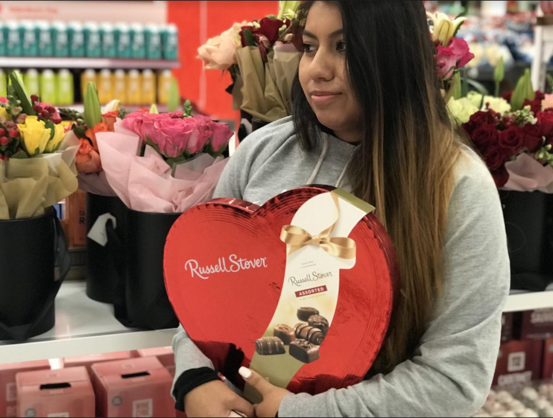 Santa Rosa resident Jasmine Rosas buys herself a box of chocolates for Valentine's Day.