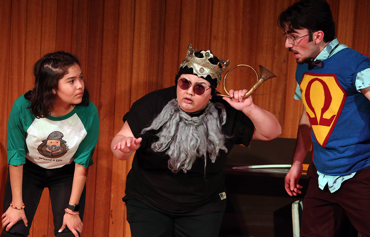 Jasmine Flores-Nunez(left), Alexx Valdez(middle) and Christopher Shayota(right) play a student teacher, high school coach and theater professor whose job is to help a group of high school students, the audience, graduate.