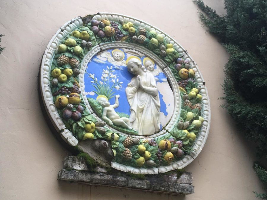 The piece adorning the wall was brought in from Italy and is now featured at the Chapel of Chimes in Santa Rosa. The fountain seeks to evoke a Renaissance Fresco style.