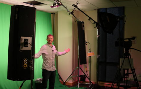 Digital filmmaking instructor Brian Antonsen shows off the one switch  lighting in the green screen room.