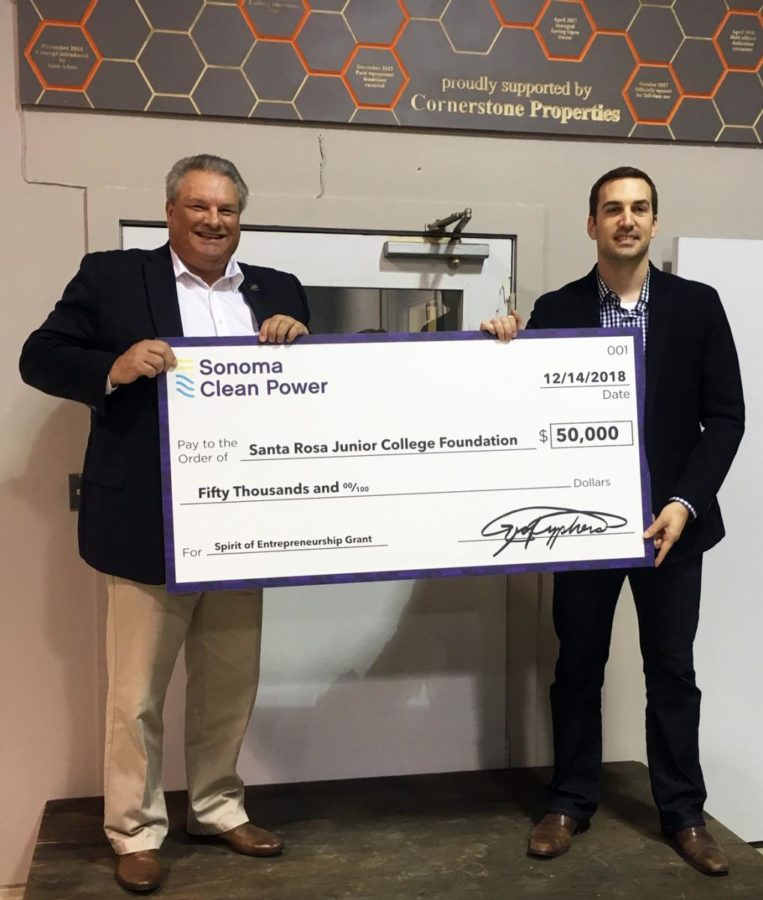 Nathan Kinsey, Commercial Accounts Manager at Sonoma Clean Power stands with Jerry Miller., dean of Career Education. The check is now in the Business office in Maggini Hall at Santa Rosa Junior College.