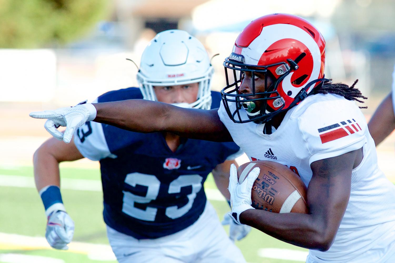 Fresno City wide receiver Michael Gates (3) directs traffic down field after a reception in the 2019 season opener at the Santa Rosa High School football field September 7 in Santa Rosa.