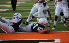 Bear Cubs lose home opener despite Heckman's two touchdowns