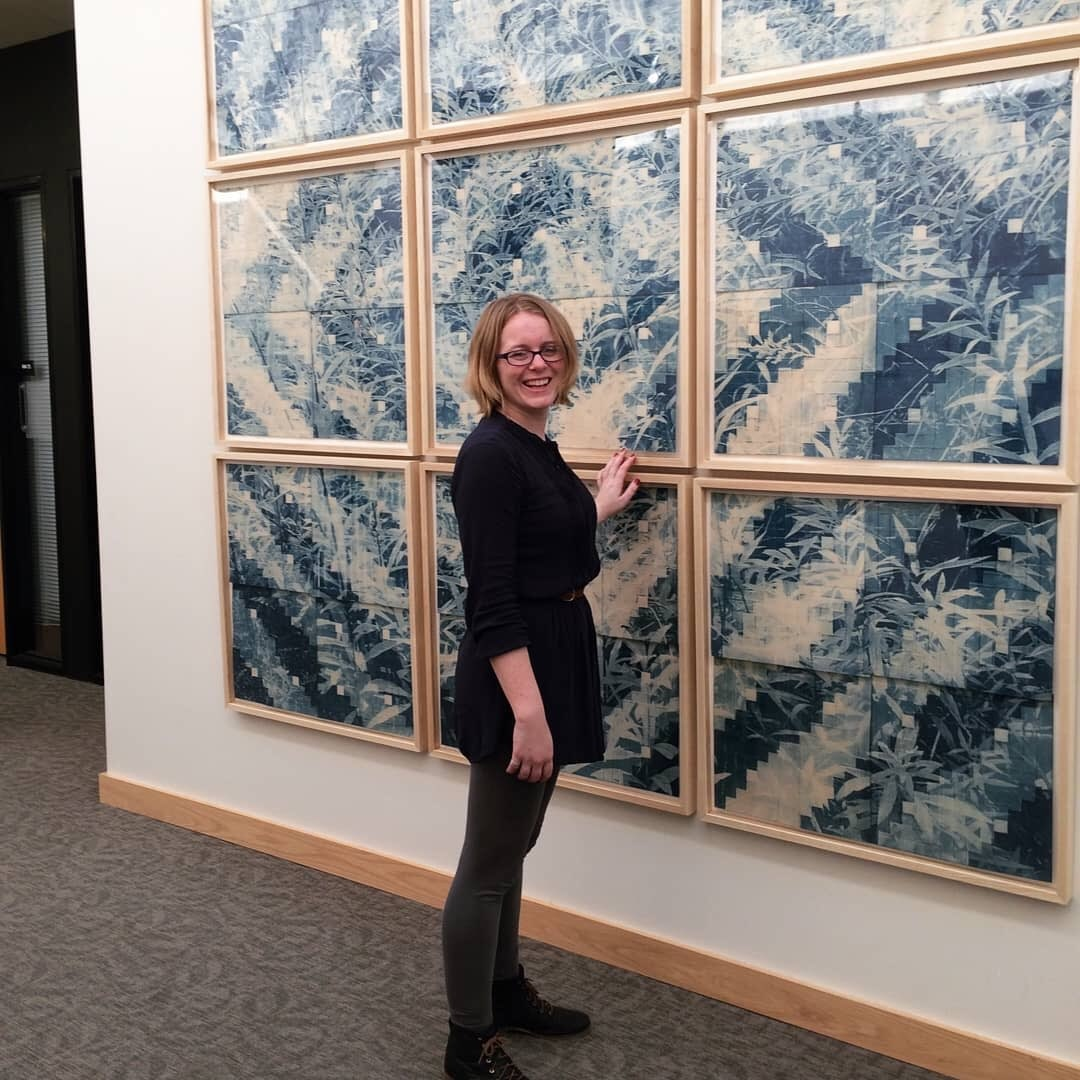 Robert F. Agrella Gallery art director and printmaking professor Hannah Skoonberg, stands with her own art during a printmaking exhibition called