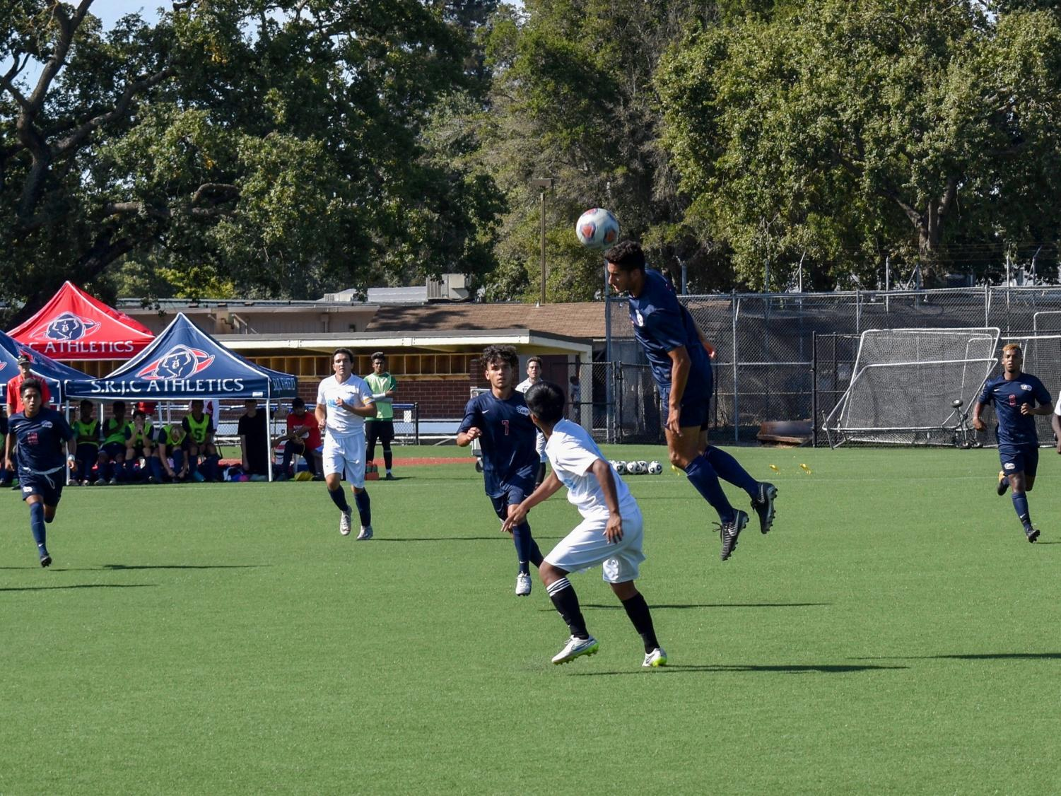 SRJC defenseman Matias Gomez goes up for a header in the first half of Wednesday's home opener versus Contra Costa. The Bear Cubs trounced their opponent 12-0.