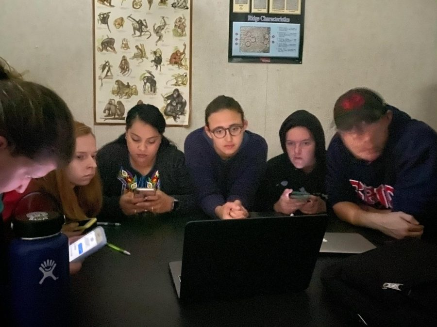 Anthropology Lab students watch ABC7 news' live stream in the dark during the Oct. 22 lockdown.