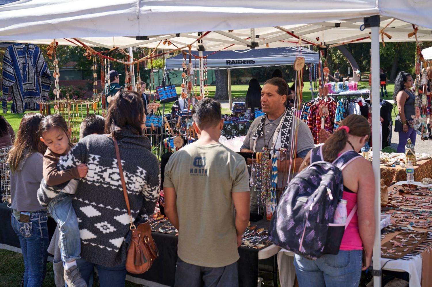 A vendor sells necklaces at SRJC's Indigenous People's Day celebration in Bertolini Quad.
