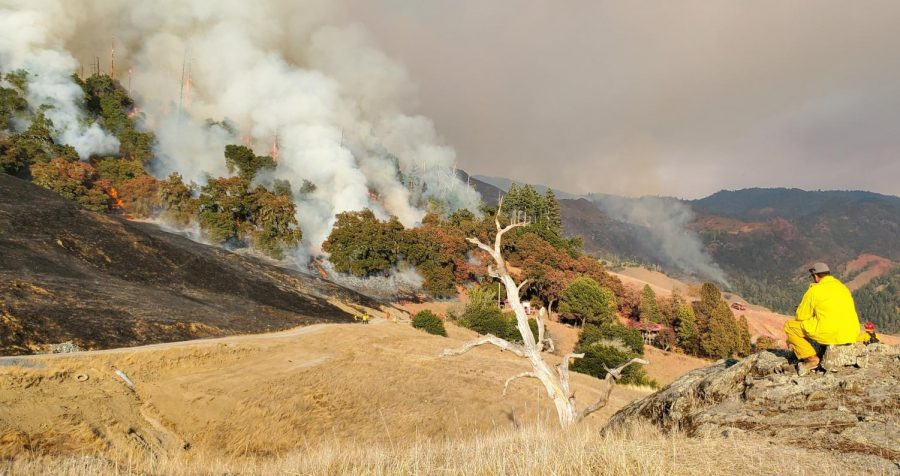The Kincade fire sweeps down a hillside near Alexander Valley.
