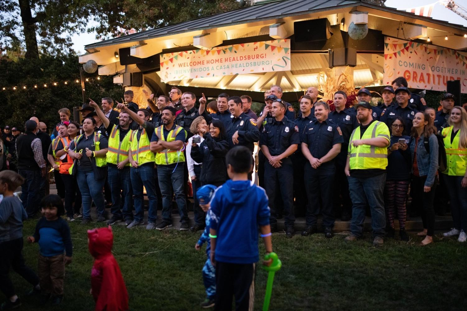 Firefighters, police officers and Healdsburg city staff gather Friday, Nov. 8 at the Healdsburg Plaza on the night of