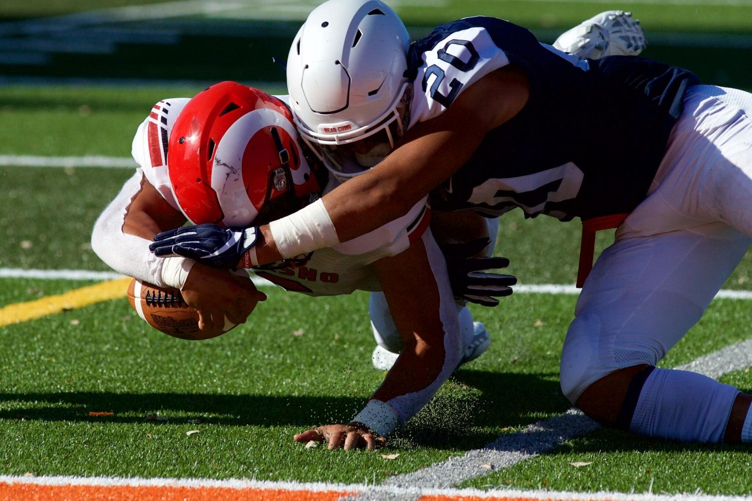 SRJC safety Kasey Kikuyama demonstrates a perfect form tackle against Fresno College Sept. 7. Though there is slight helmet to helmet contact, Kikuyama leads with his shoulder and wraps up nicely.