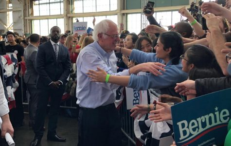 Senator Bernie Sanders embraces a loving fan at a recent rally in Richmond, CA. The energy in the crowd is electric as Sanders takes the time to shake hands and hug fans at the front of the audience.