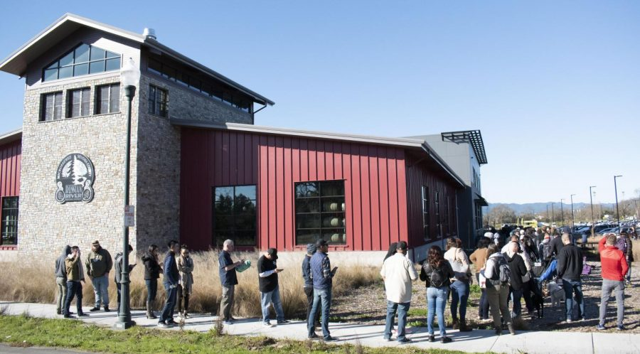 Hundreds of eager beer drinkers line up outside the Russian River Brewing Company's (RRBC) headquarters in anticipation of the brewery's annual release of their world-famous Pliny the Younger beer, Feb. 7 in Windsor.