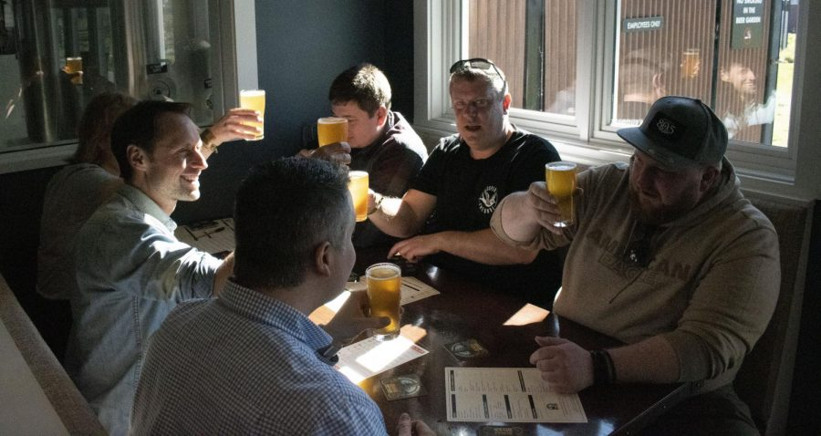 A group of German beer enthusiasts raise their first-ever glasses of Pliny the Younger.