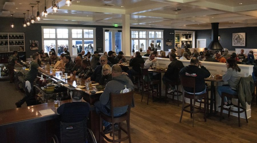 The first wave of people taste the much-anticipated Pliny the Younger in RRBC's main dining room, while hundreds continue to wait their turn in line outside.