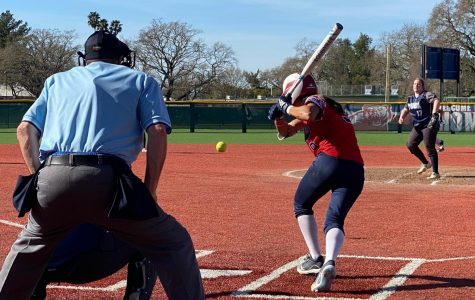 Bear Cubs left-handed slapper Anna Zoia-Buescher hits the ball to left field for a base hit in a 17-0 home victory Feb. 25 at Santa Rosa Junior College.