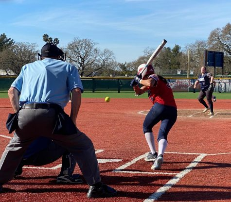 Bear Cubs women's softball puts on a hitting clinic in a decisive victory