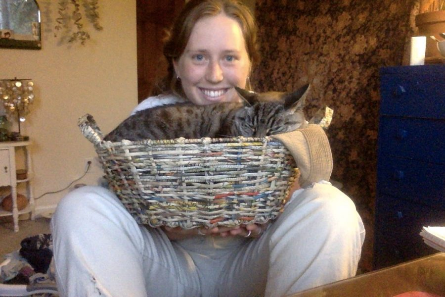 Alexis Trinei, who loves being at home during the pandemic, and her cat Lucy.