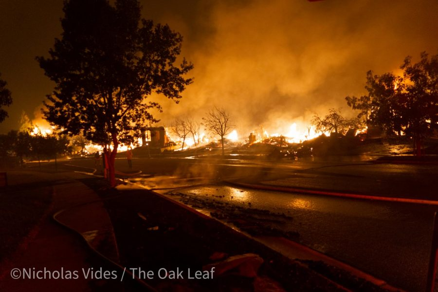 The Shady Fire burns through the 5800 block of Mountain Hawk Drive at 3:30 a.m. Monday.