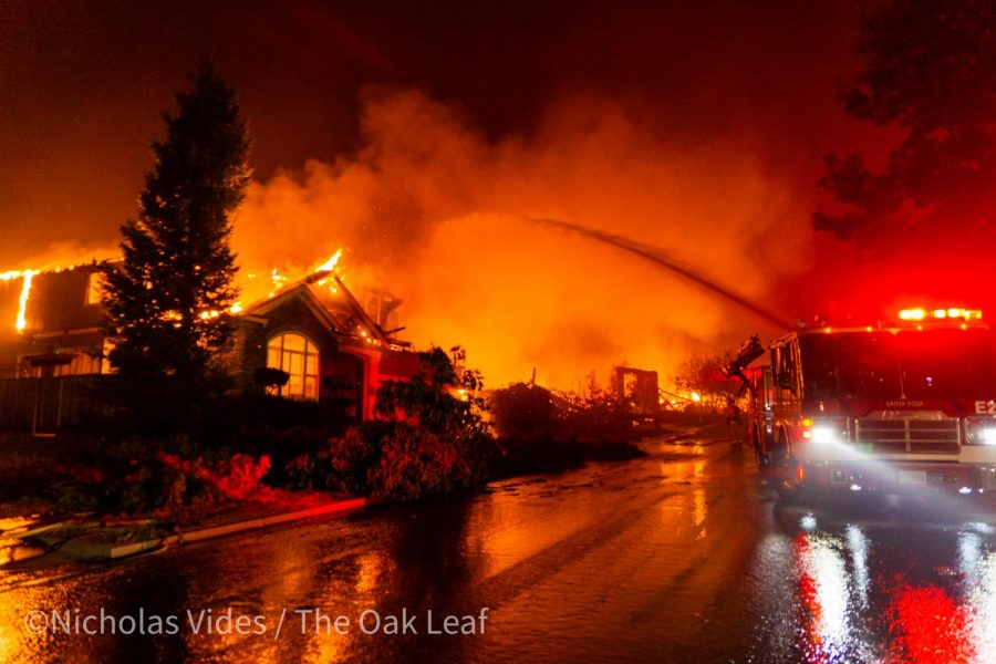 Firefighters on Mountain Hawk Road fight devastating flames as the Shady Fire moves in on eastern Santa Rosa early Monday morning.