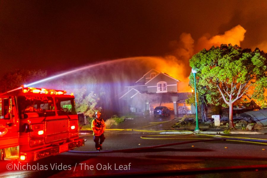 An engine douses a house on Mountain Hawk Road early Monday morning to keep embers from catching other houses on fire in the Mountain Hawk Area of Santa Rosa, CA.