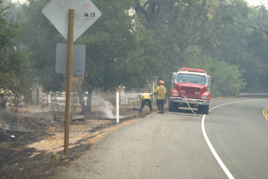 Firefighters working along Calistoga Road in east Sonoma County.