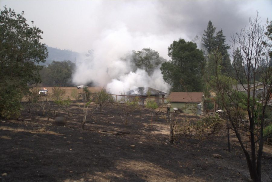 Smoke billows from a pool house as firefighters put out a fire in the Skyhawk community.