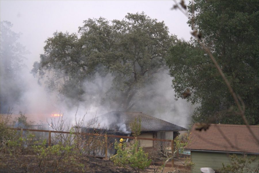 Firefighters douse flames on a pool house in east Santa Rosa's Skyhawk community.