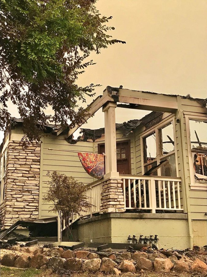 A decorative flag hangs unscathed on an otherwise destroyed house on Mountain Hawk Drive Sunday night.