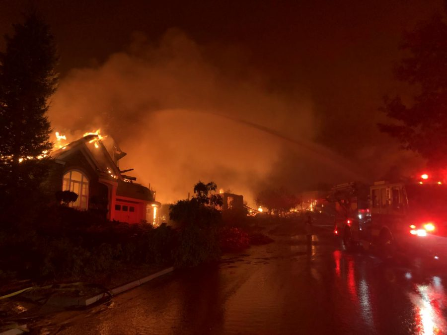 Firefighters attempt to save homes on Mountain Hawk Drive in Santa Rosa's Skyhawk community at around 3:45 a.m. Sept. 28.