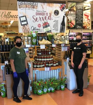 SRJC student Amy Aguilar Lopez (pictured left) and former SRJC student Julia Dearing (pictured right) ensure customers wear adequate personal protective equipment inside Oliver's Market.