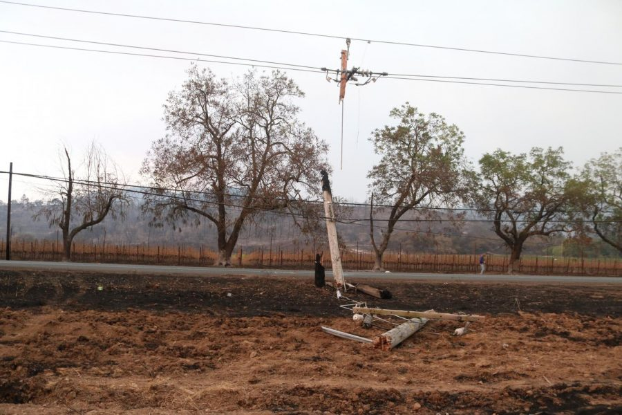 A utility pole along Hwy 12 that caught fire, resulting in the pole splintering into three pieces.