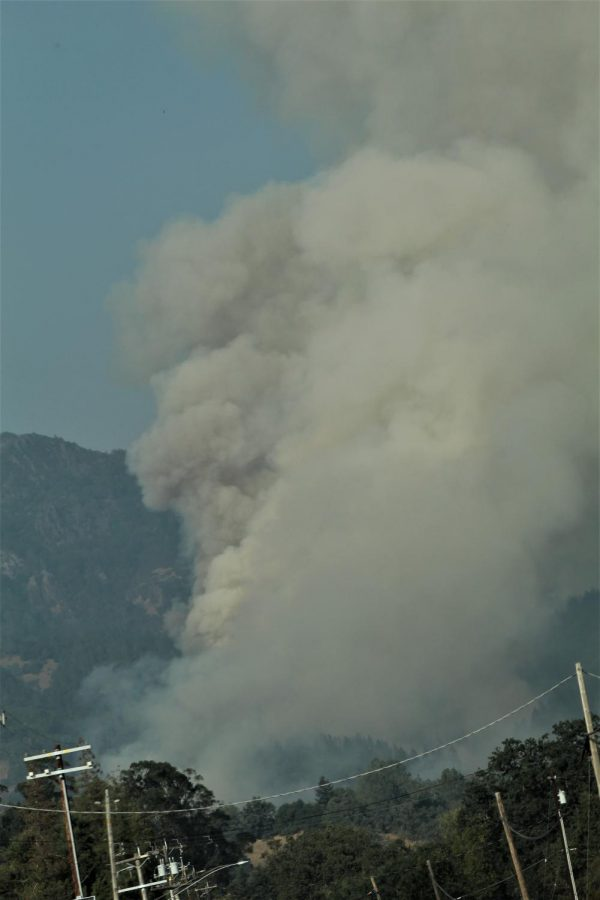 Plumes of smoke billow into the air over Highway 128.