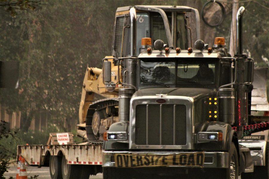 A semi hauls a dozer to the fire lines.