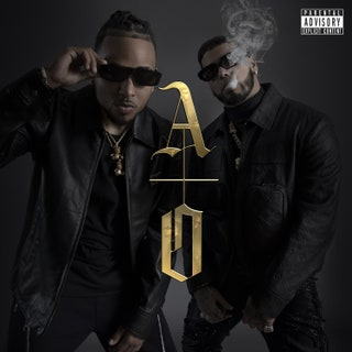 The album cover of Anuel AA and Ozunas Los Dioses, featuring the men standing in a smoky room wearing dark clothing.