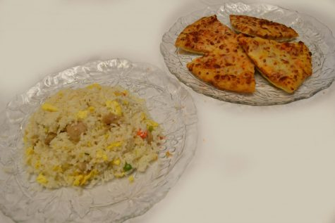 A plate of fried rice is on the left and a plate of cheese pizza is on the right.